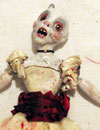 very singed ghost doll
